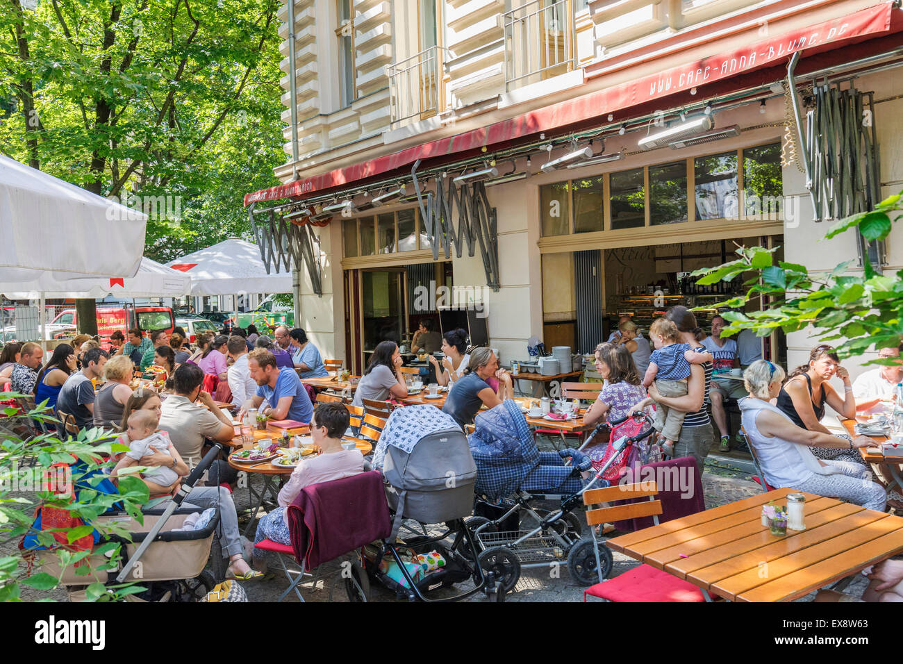 Busy Anna Blume cafe in summer in Prenzlauer Berg district of Berlin Germany - Stock Image