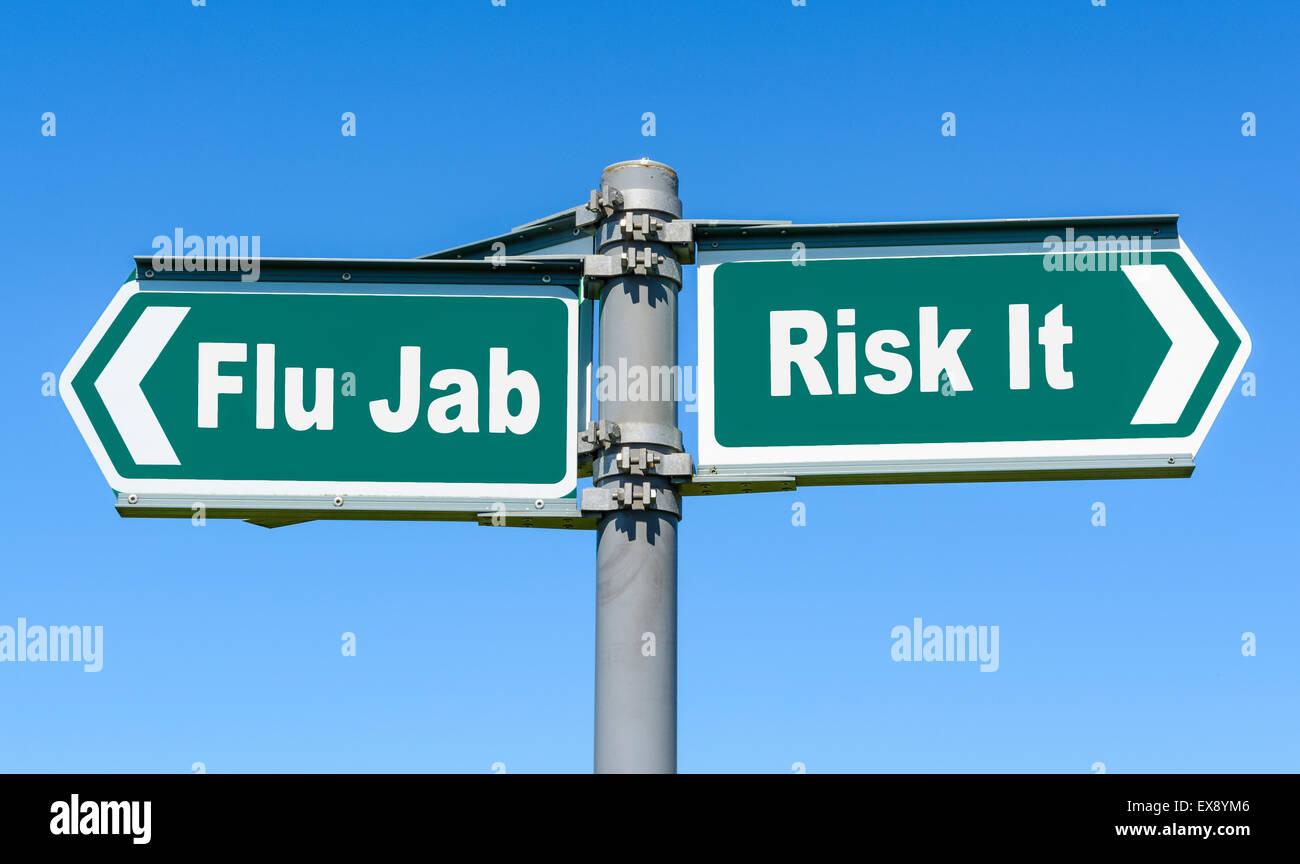 Flu Jab or Risk It direction sign. - Stock Image