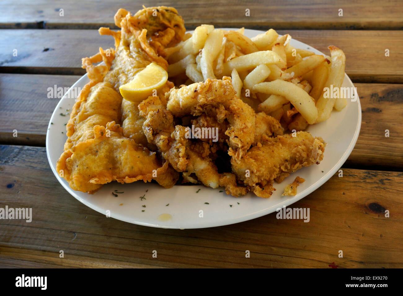 Fried fish & calamari at' Die Visvlekhuis' seafood restaurant in the coastal fishing village Velddrif - Stock Image