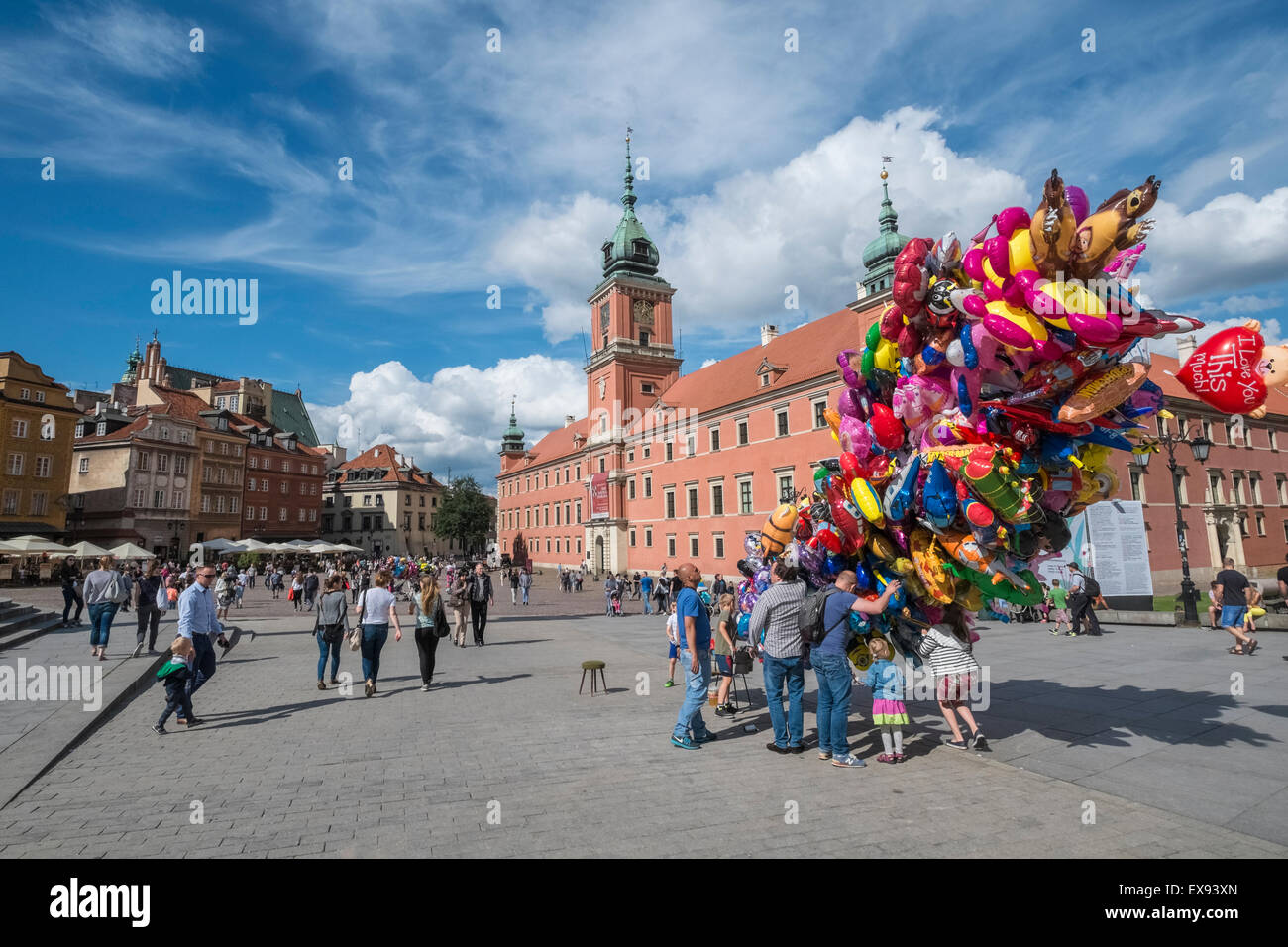 Balloon seller on Castle Square on a bright summers day, with Royal Castle building in background, Old Town, Warsaw, - Stock Image