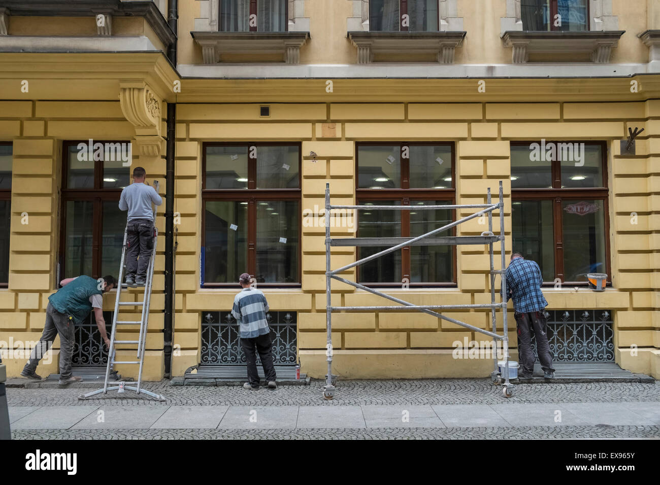 Tradesmen decorating building exterior, Wroclaw, Poland - Stock Image
