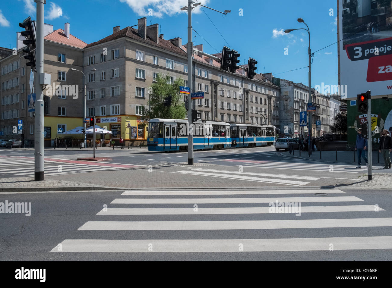 Pedestrian zebra crossing at busy tram and road intersection, Wroclaw, Poland Stock Photo