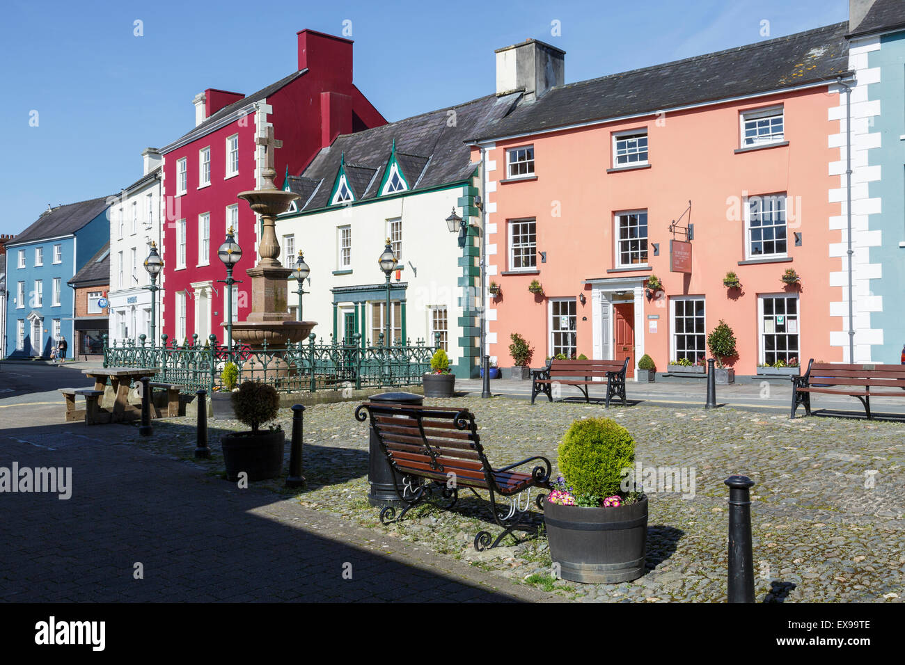 Colourful buildings in the Market Square, Llandovery, Carmarthenshire, Wales - Stock Image