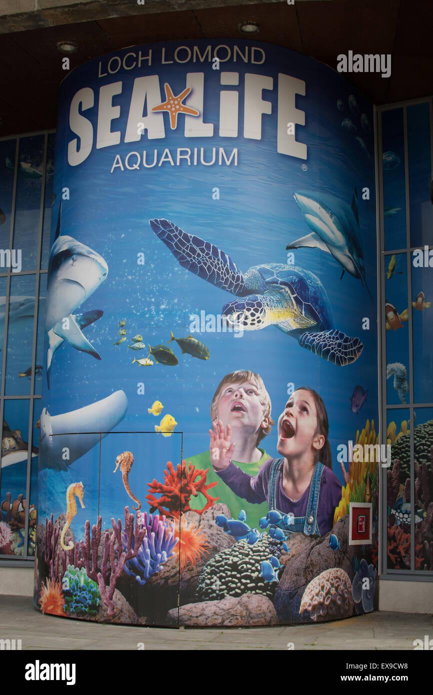 LOCH LOMOND SHORES, BALLOCH, SCOTLAND, UK - 9 JULY 2015: Loch Lomond Sea Life Aquarium sign and entrance - Stock Image