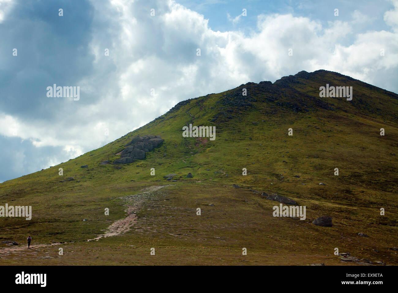 A walker ascending Bynack More, Cairngorm National Park, Badenoch & Speyside - Stock Image