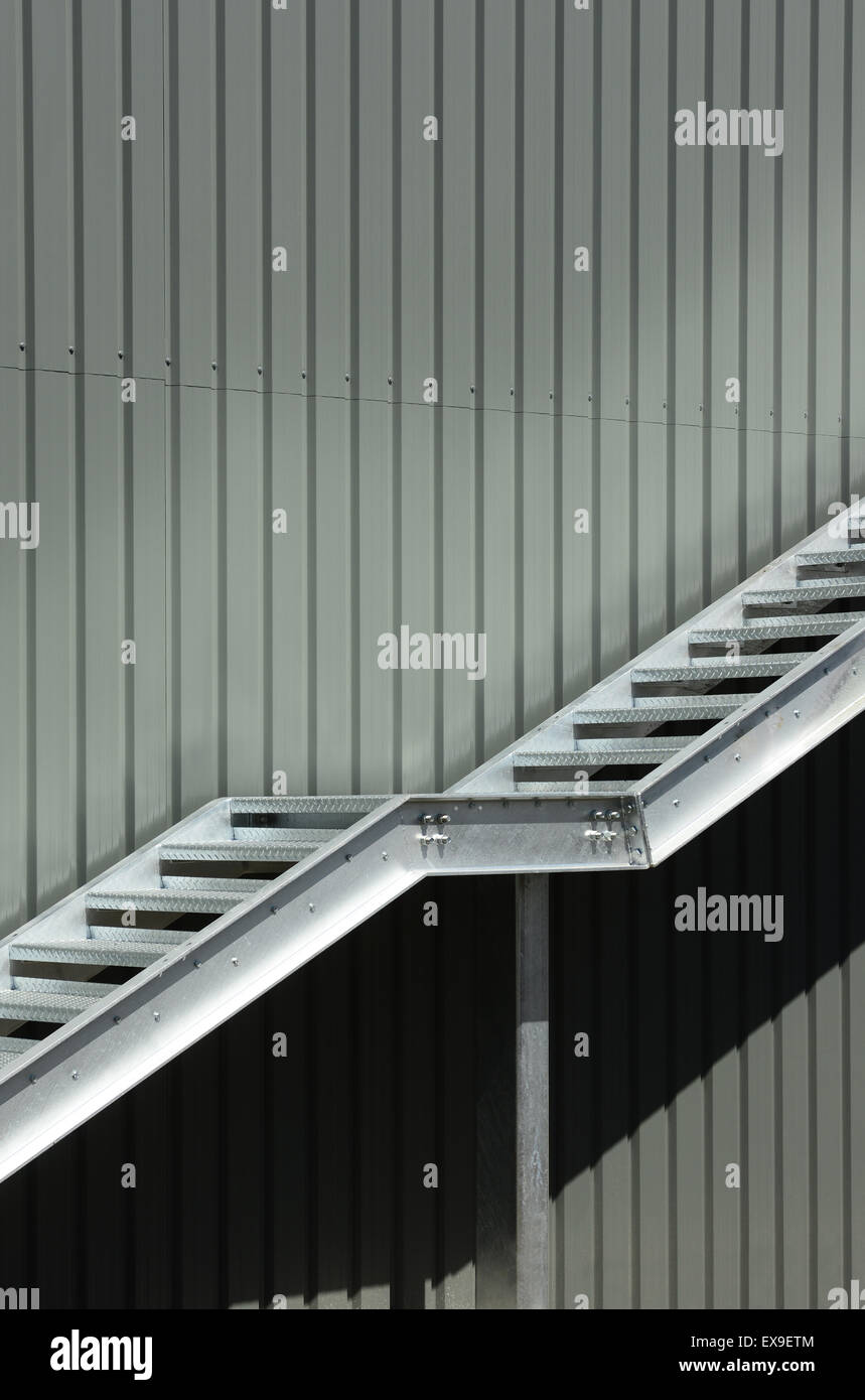 Metal Staircase Rising Up The Outside Of A Steel Clad Warehouse   Stock  Image