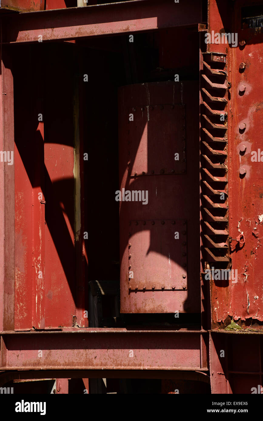 Old metal machinery painted red Stock Photo