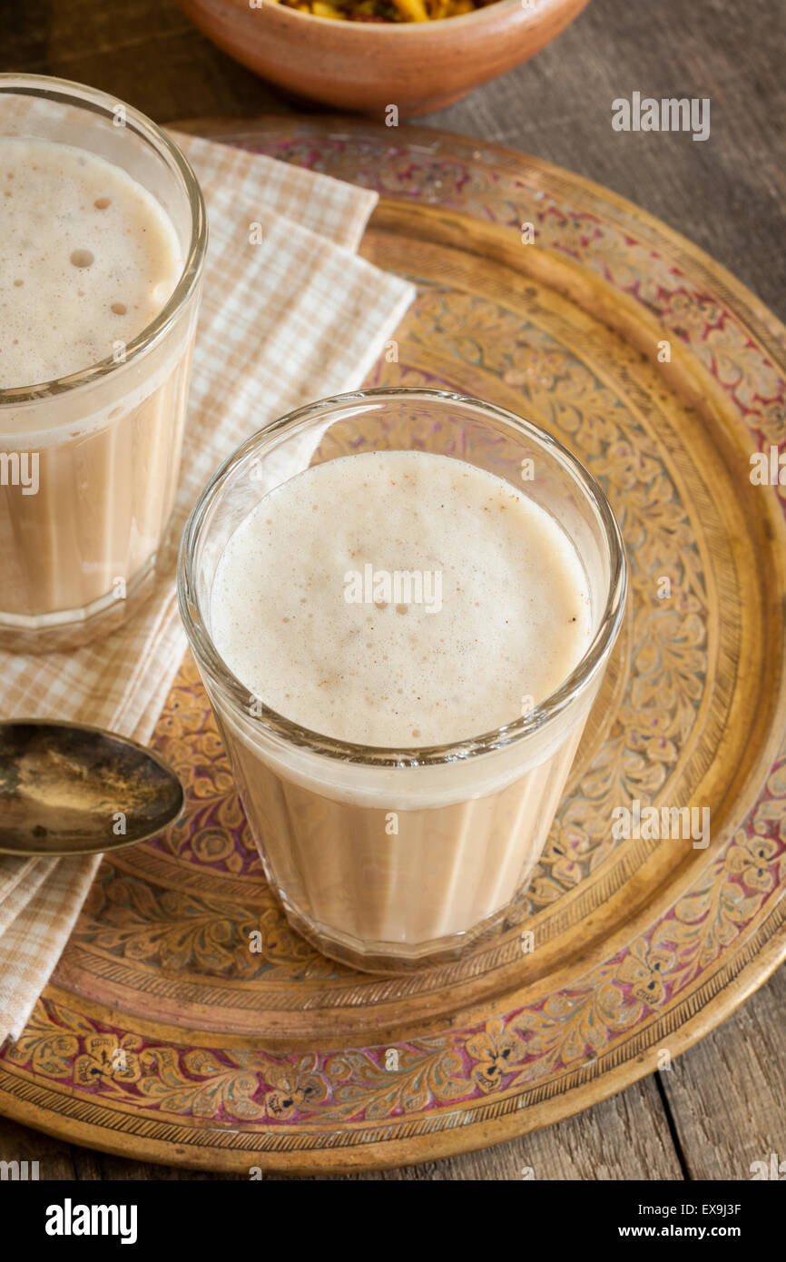 Masala Chai a blend of black tea made with milk and various aromatic spices Stock Photo