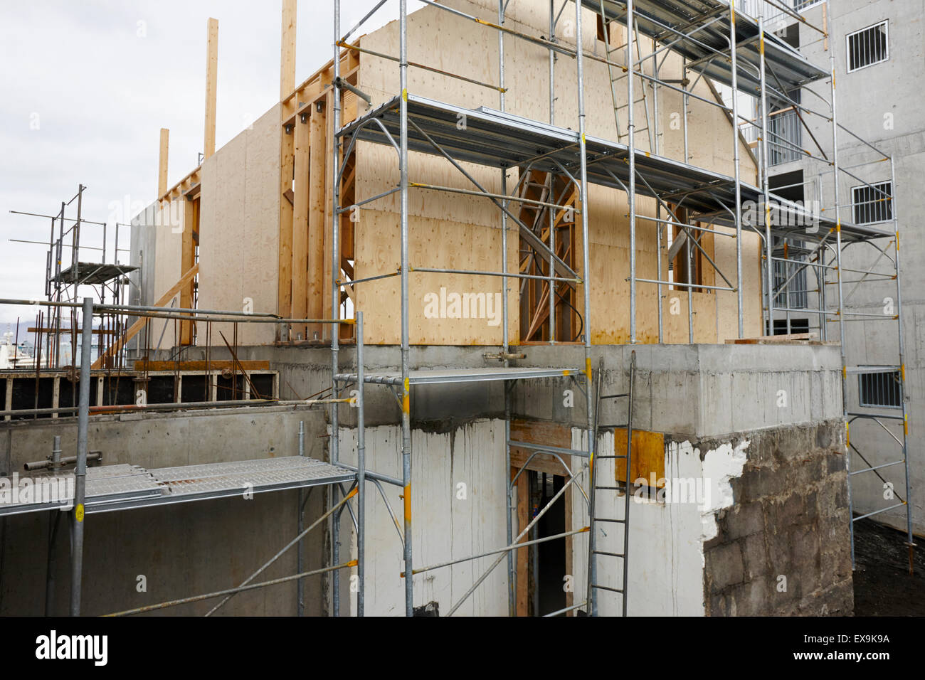 typical construction of timber framed house over block and concrete basement in reykjavik iceland Stock Photo