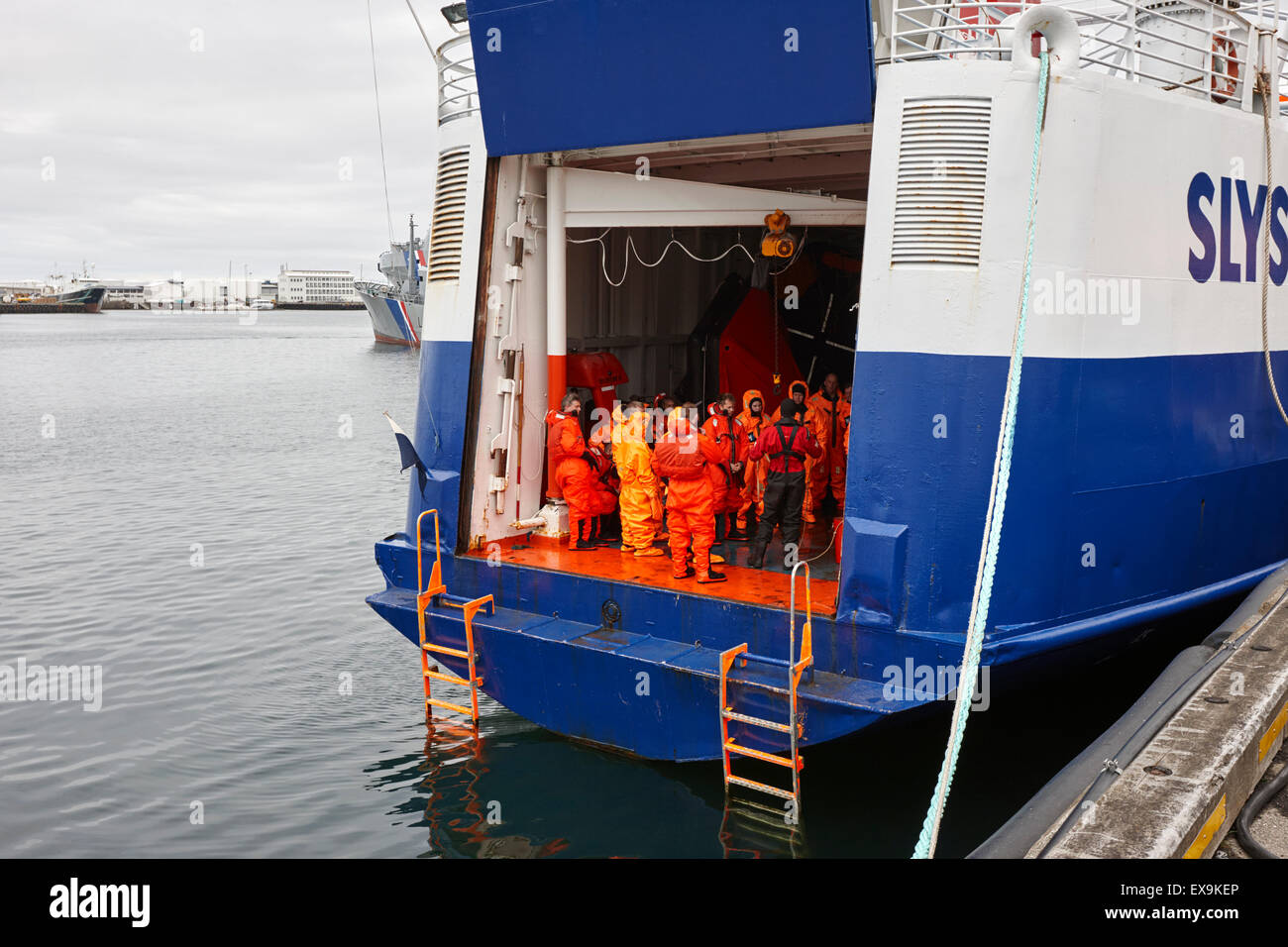students with immersion suits undergoing maritime search and rescue training on ship reykjavik iceland - Stock Image