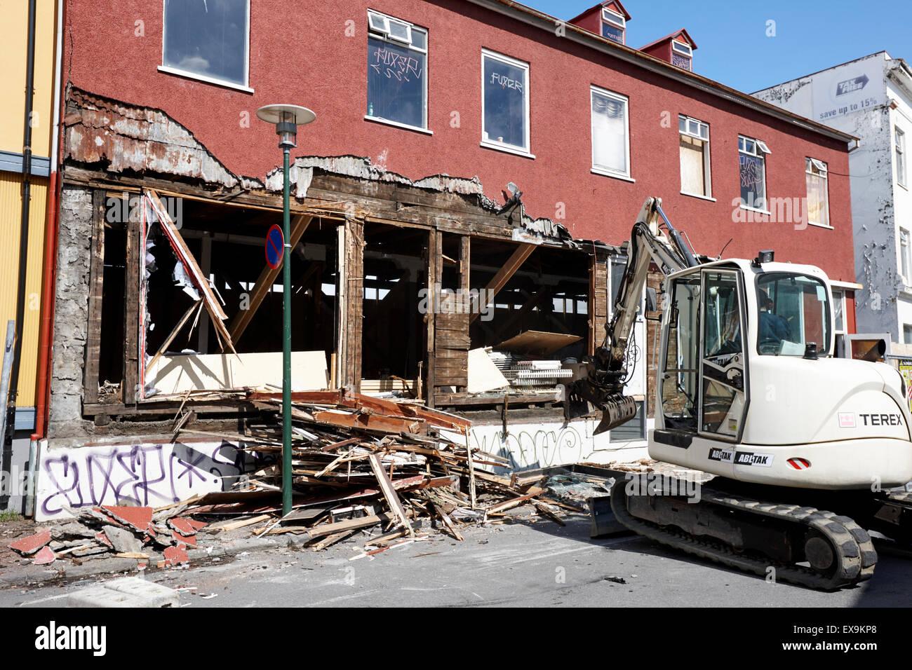 demolishing stucco corrugated iron clad wood framed building reykjavik iceland - Stock Image