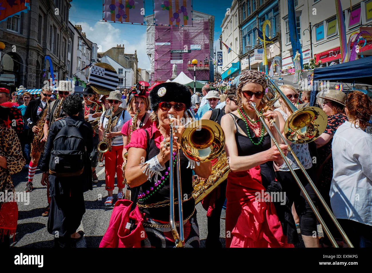 Maze Day - the Breton street band Pattes a Caisse lead one of the colourful parades on Mazey Day, part of the Golowan - Stock Image