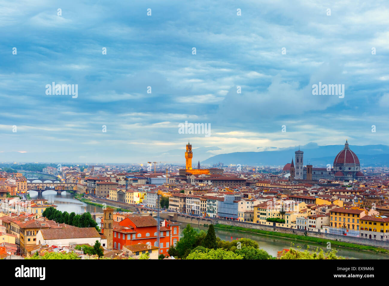 Famous view of Florence at night, Italy - Stock Image