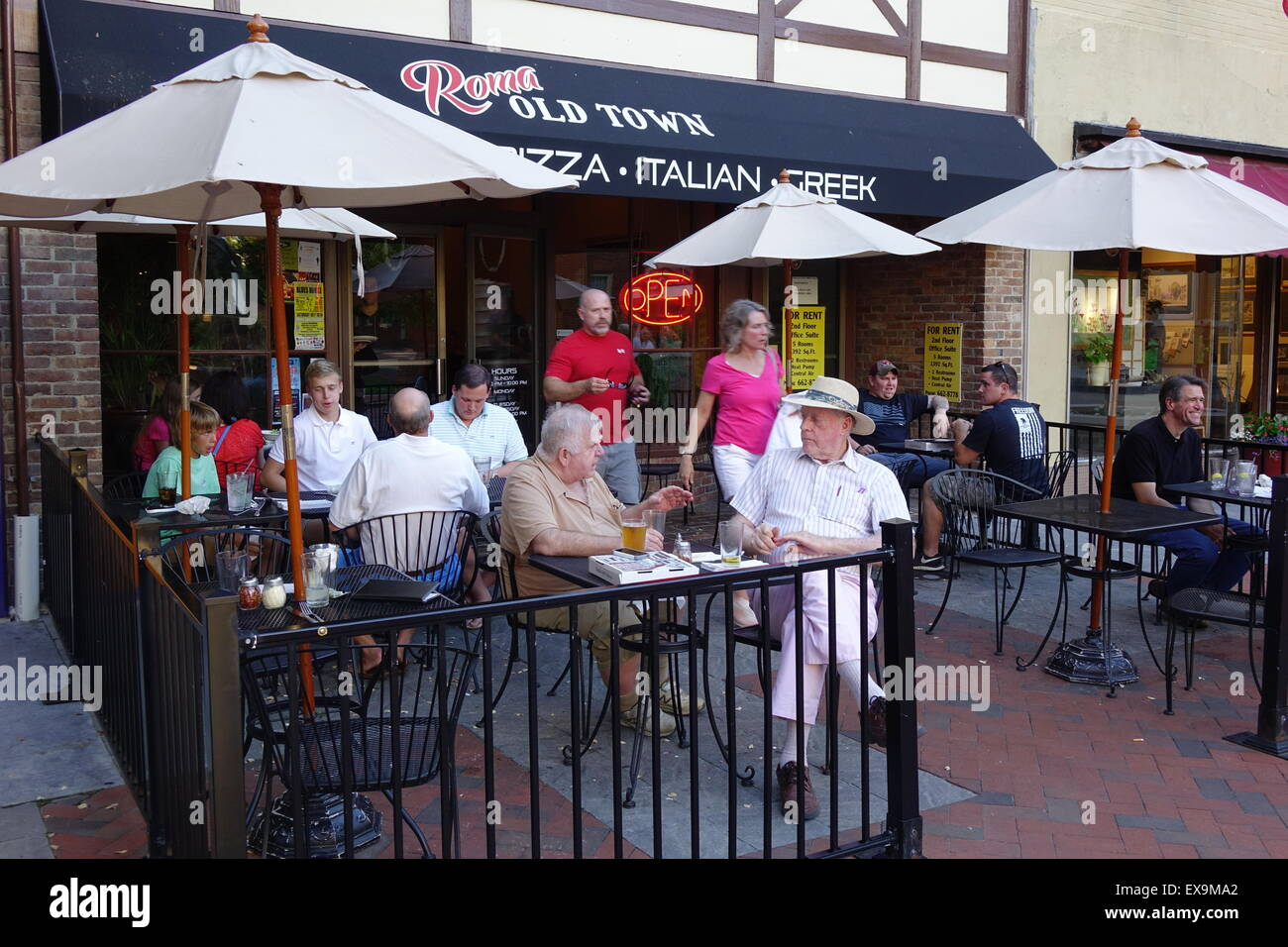Diners gathered at Roma Old Town restaurant at the Old Town pedestrian mall, Winchester, Virginia - Stock Image