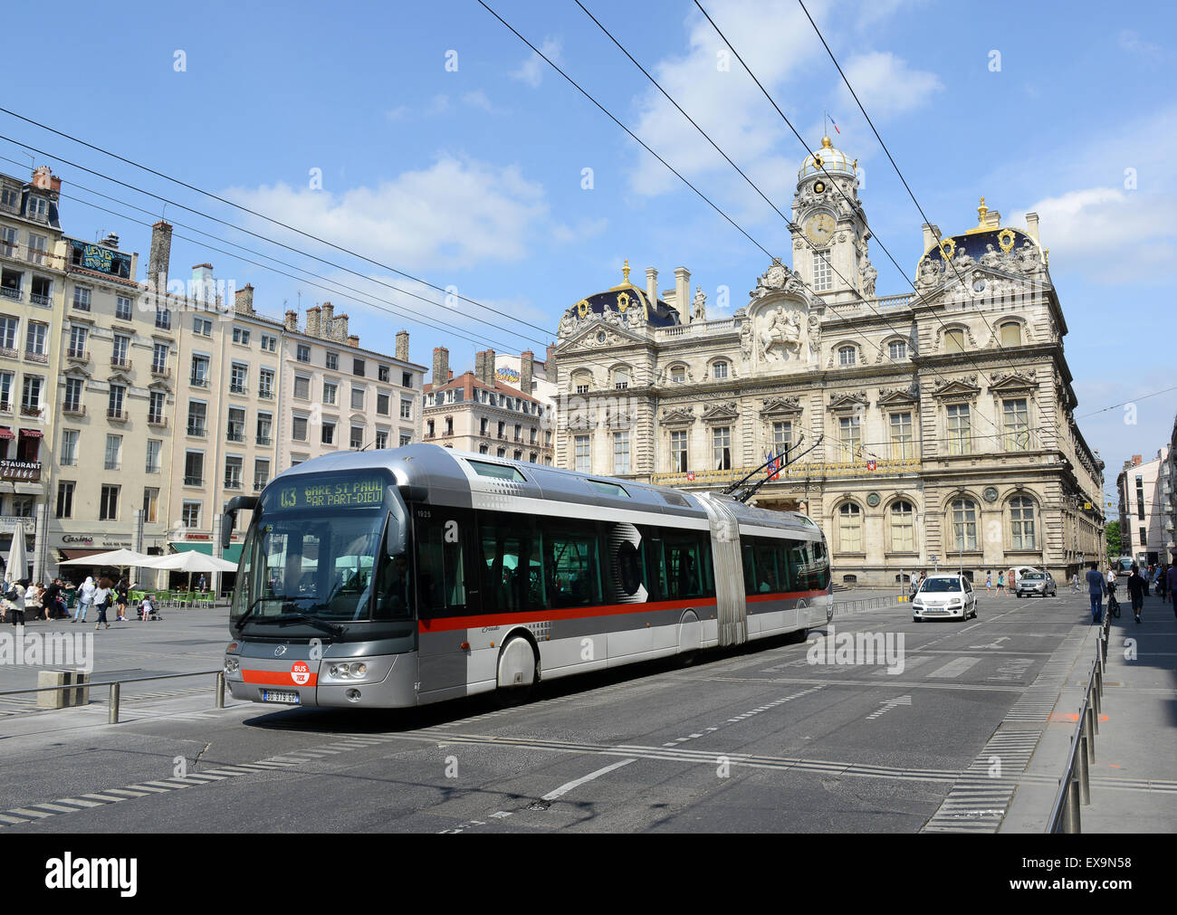 Public transport electric tram trams bus buses Lyon France French - Stock Image