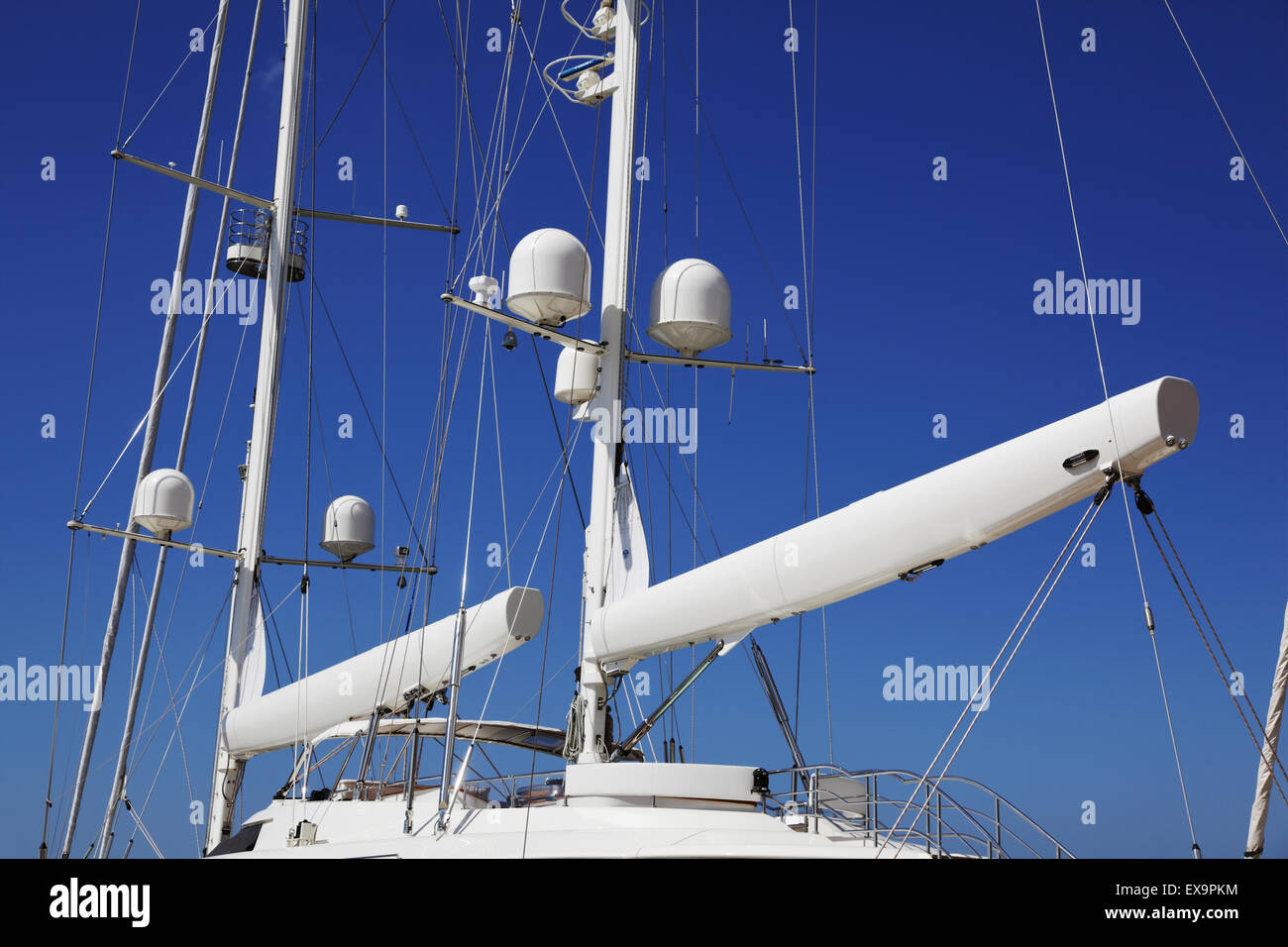 Chania city, Crete Island, Greece - JUNE 12, 2013: Masts and rigging of a luxury yacht close-up against a blue sky - Stock Image