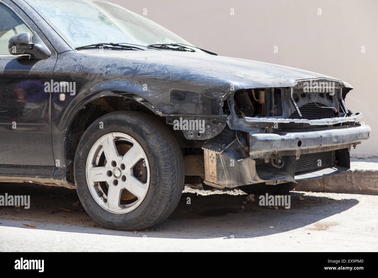 Chania Town, Crete Island, Greece - JUNE 17, 2013: Crashed Abandoned Car On Street - Stock Image