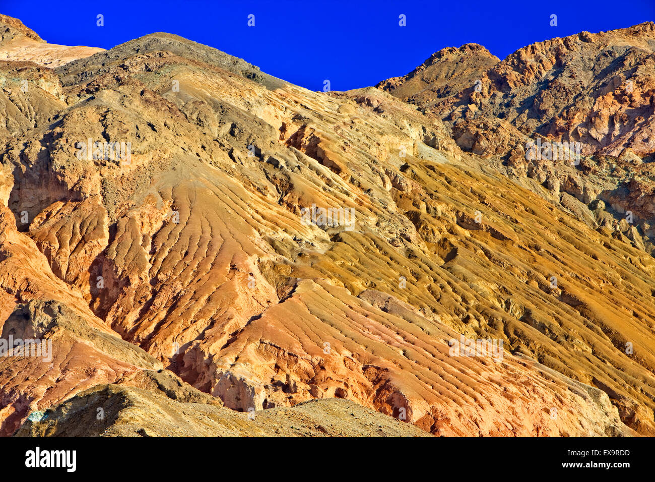 Face of Black Mountains with various colors of rock (different minerals), Along Artists Drive, Artists Palette, - Stock Image