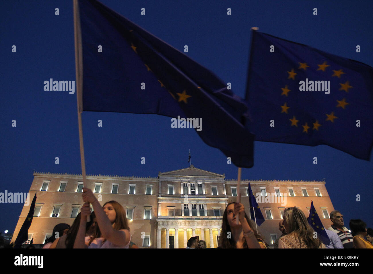 Athens, Greece. 9th July, 2015. Protesters hold European Union flags during a Pro-Euro rally in front of the parliament - Stock Image