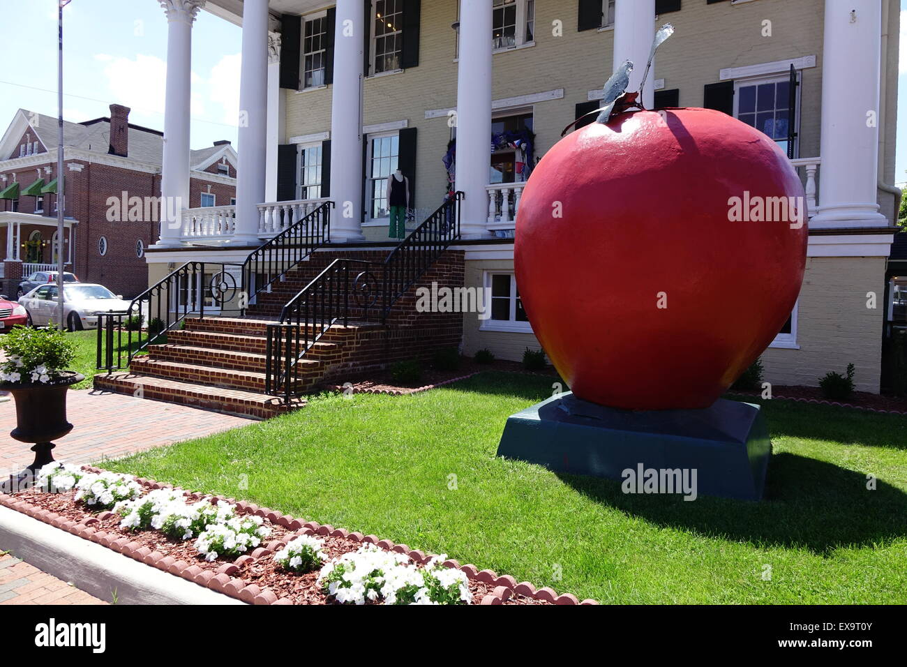 Giant red apple in front of the former headquarters of General Sheridan during the civil war, now used for offices - Stock Image