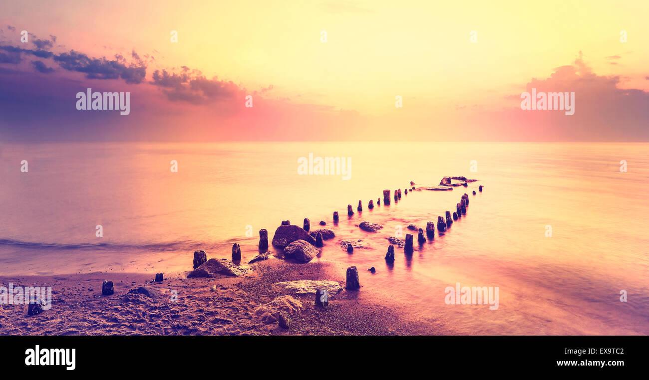 After purple sunset, peaceful sea landscape. - Stock Image