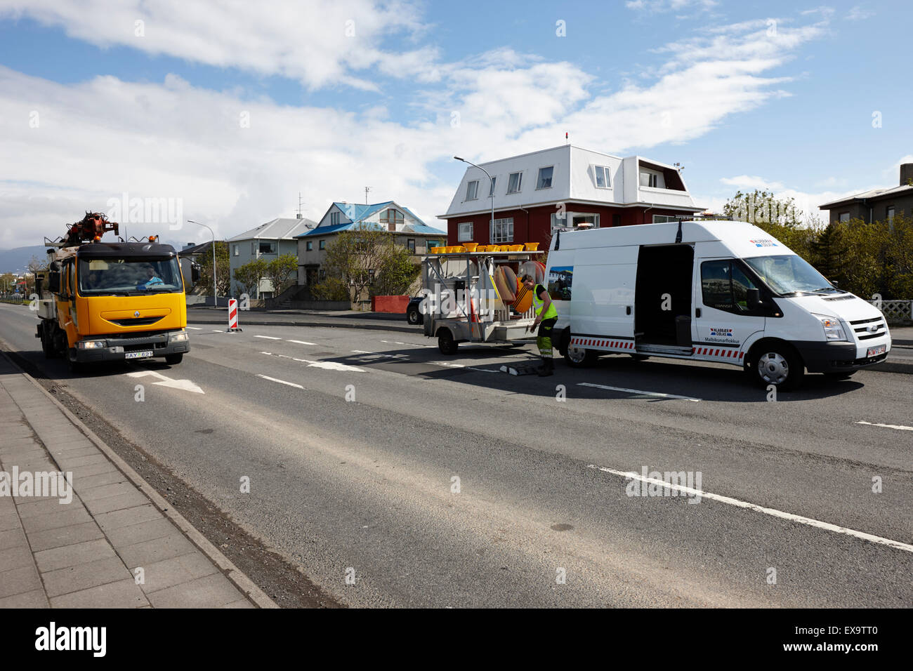 road crew out repairing potholes in reykjavik iceland - Stock Image