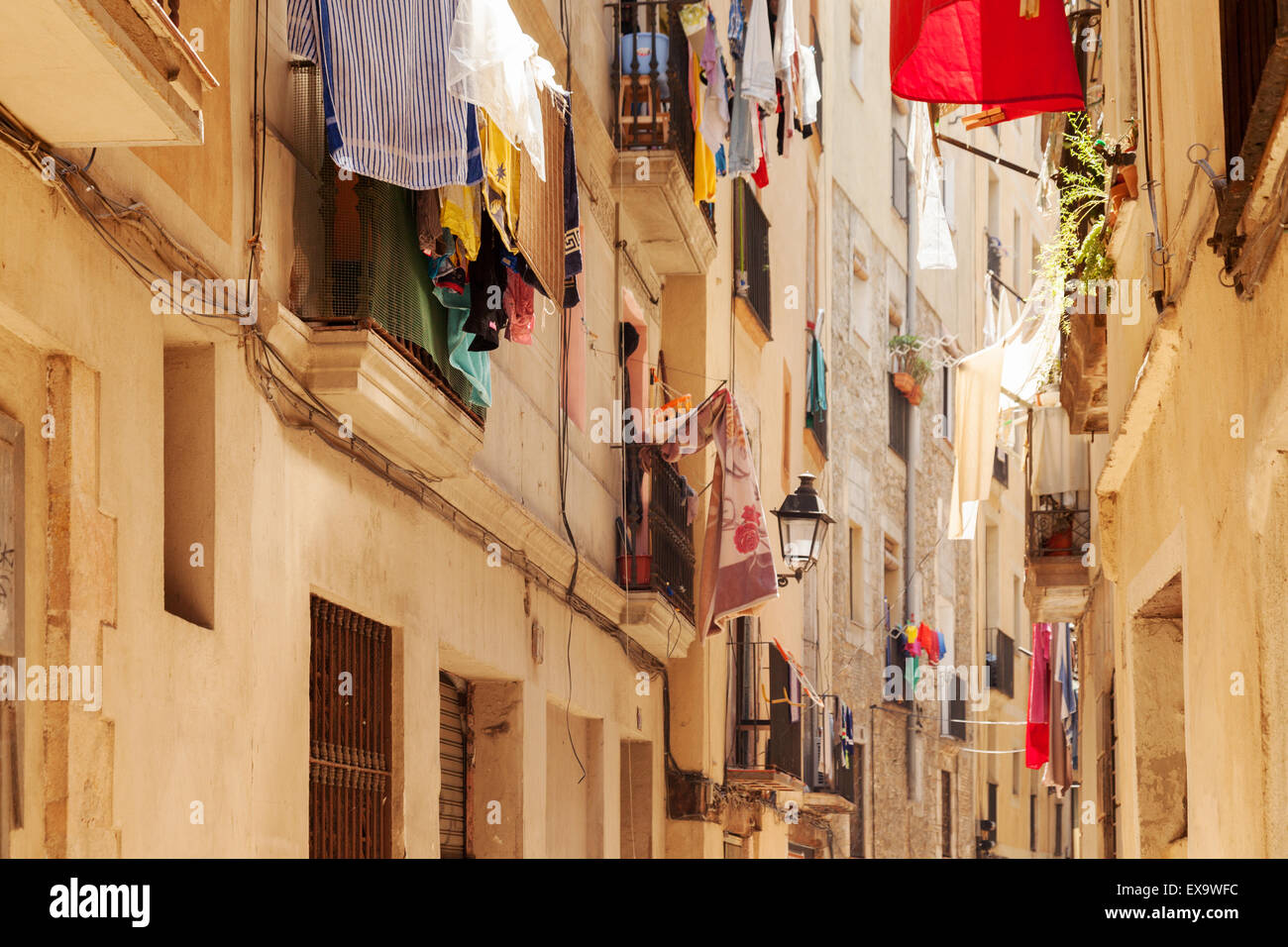 Barcelona clothes washing hanging above the street, Barri Gotic ( Gothic Quarter ), Barcelona Spain - Stock Image