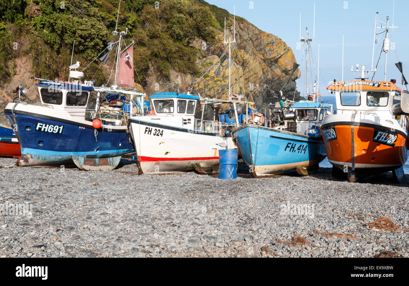 Fishing boats on the beach at Cadgwith Cove - an unspoilt viallge on the Lizard peninsula - Stock Image
