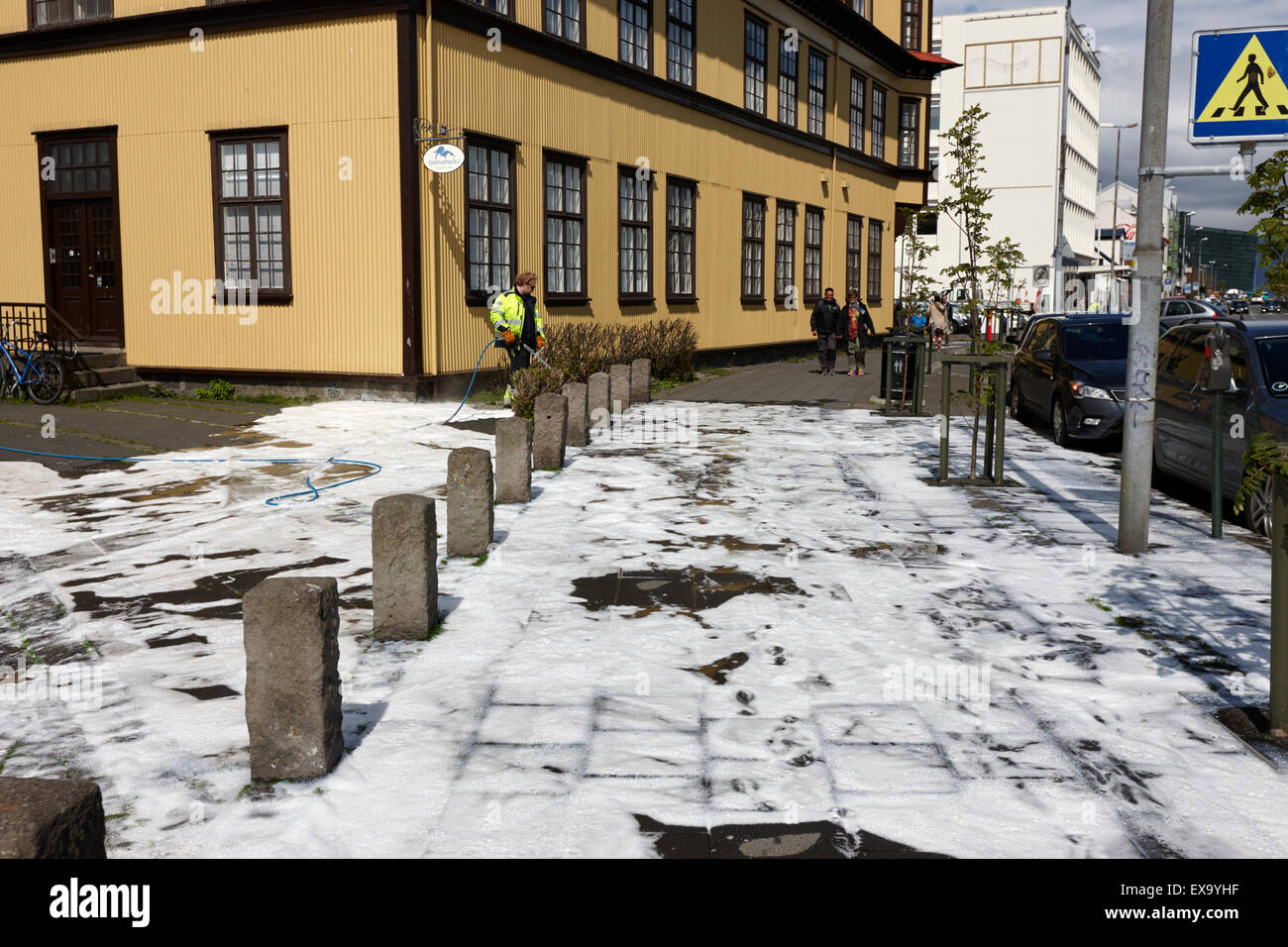 foam street pavement cleaning in reykjavik iceland - Stock Image