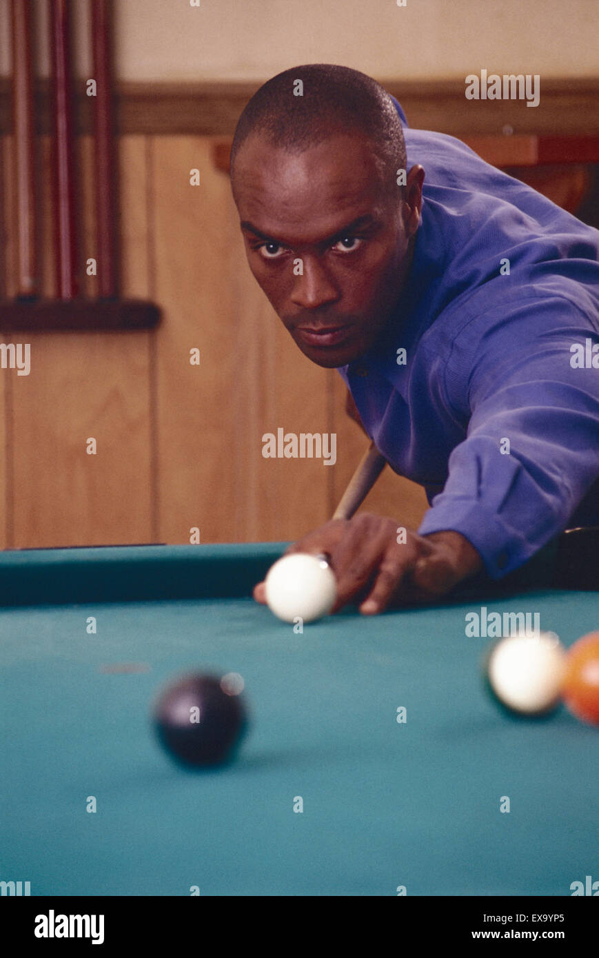 Male playing billiards. - Stock Image