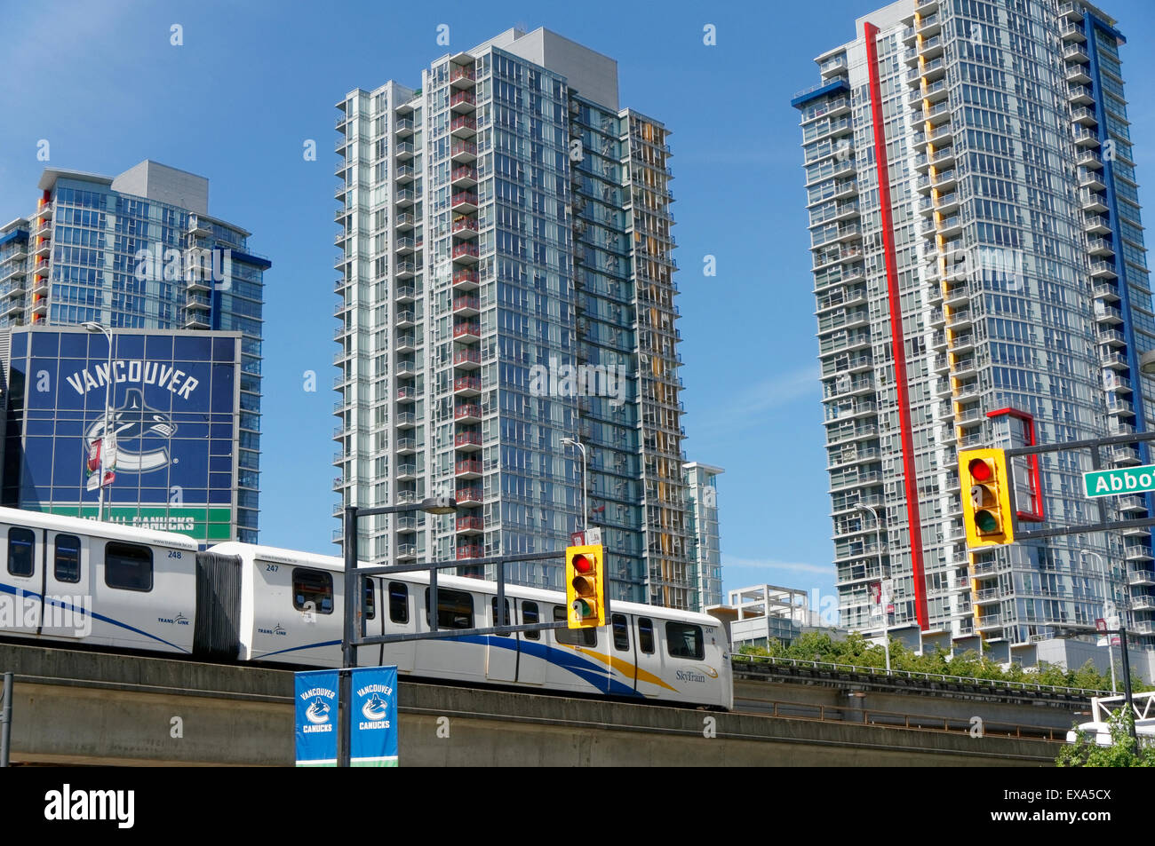 SkyTrain elevated train with newly built condominium towers in the background, Vancouver, BC, Canada Stock Photo