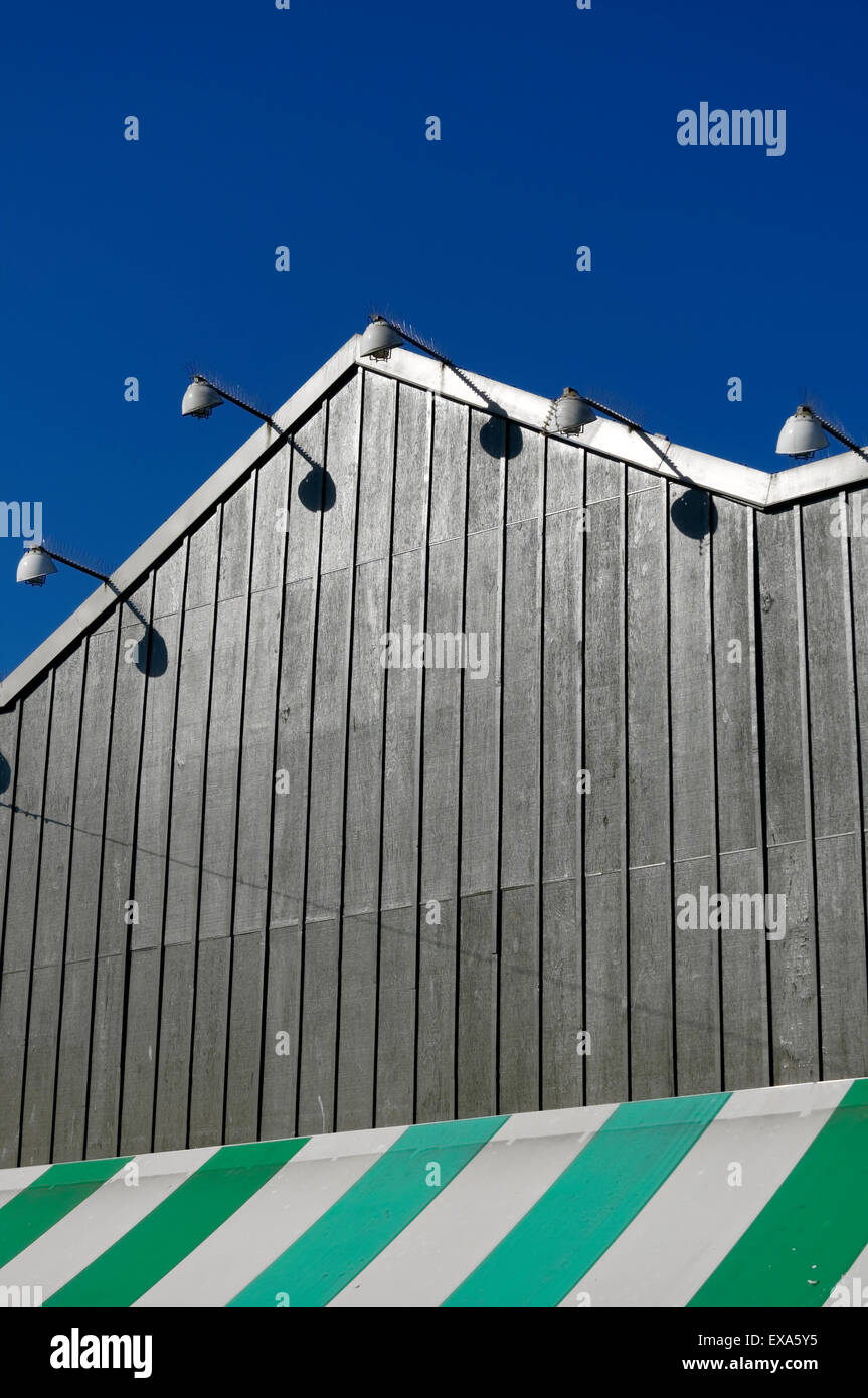 Green and white striped awning decorating a building on Granville Island, Vancouver, British Columbia, Canada - Stock Image