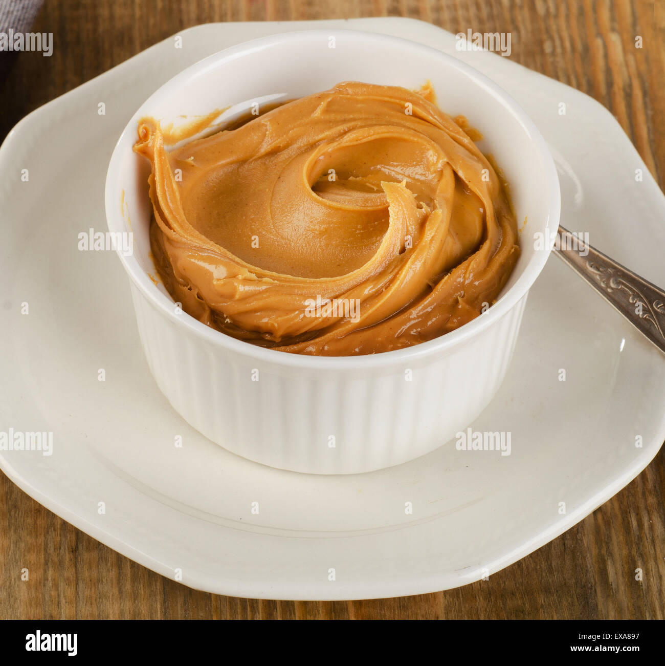 Peanut butter in a white bowl .  Shallow dof. - Stock Image