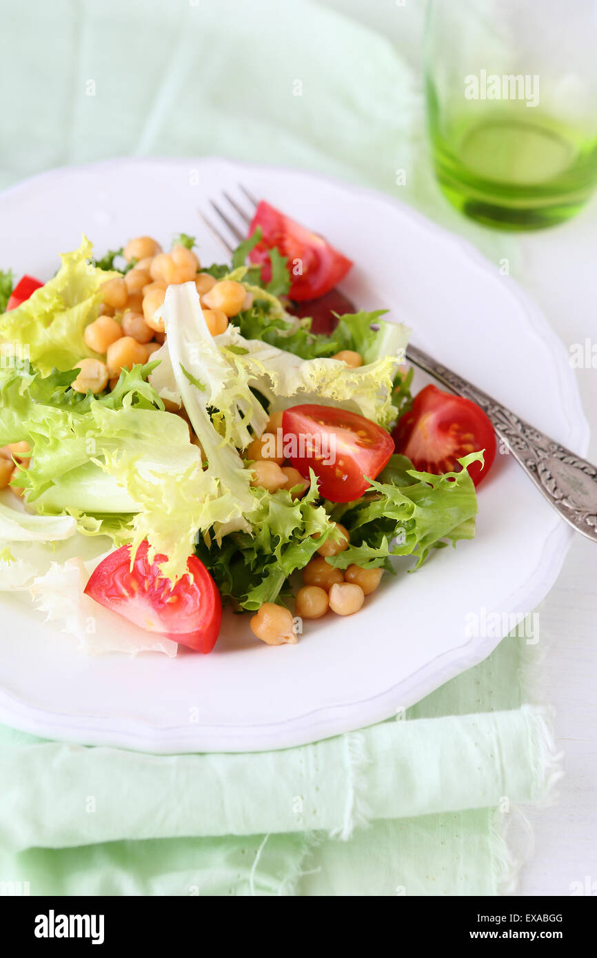 salad with chick-pea on plate - Stock Image