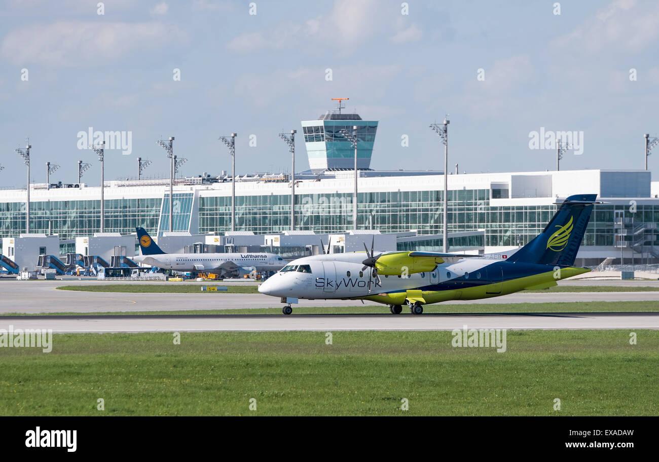 SkyWork Airlines Dornier Do-328-110, registration number HB-AER, taxying at Munich Airport, Munich, Upper Bavaria, - Stock Image