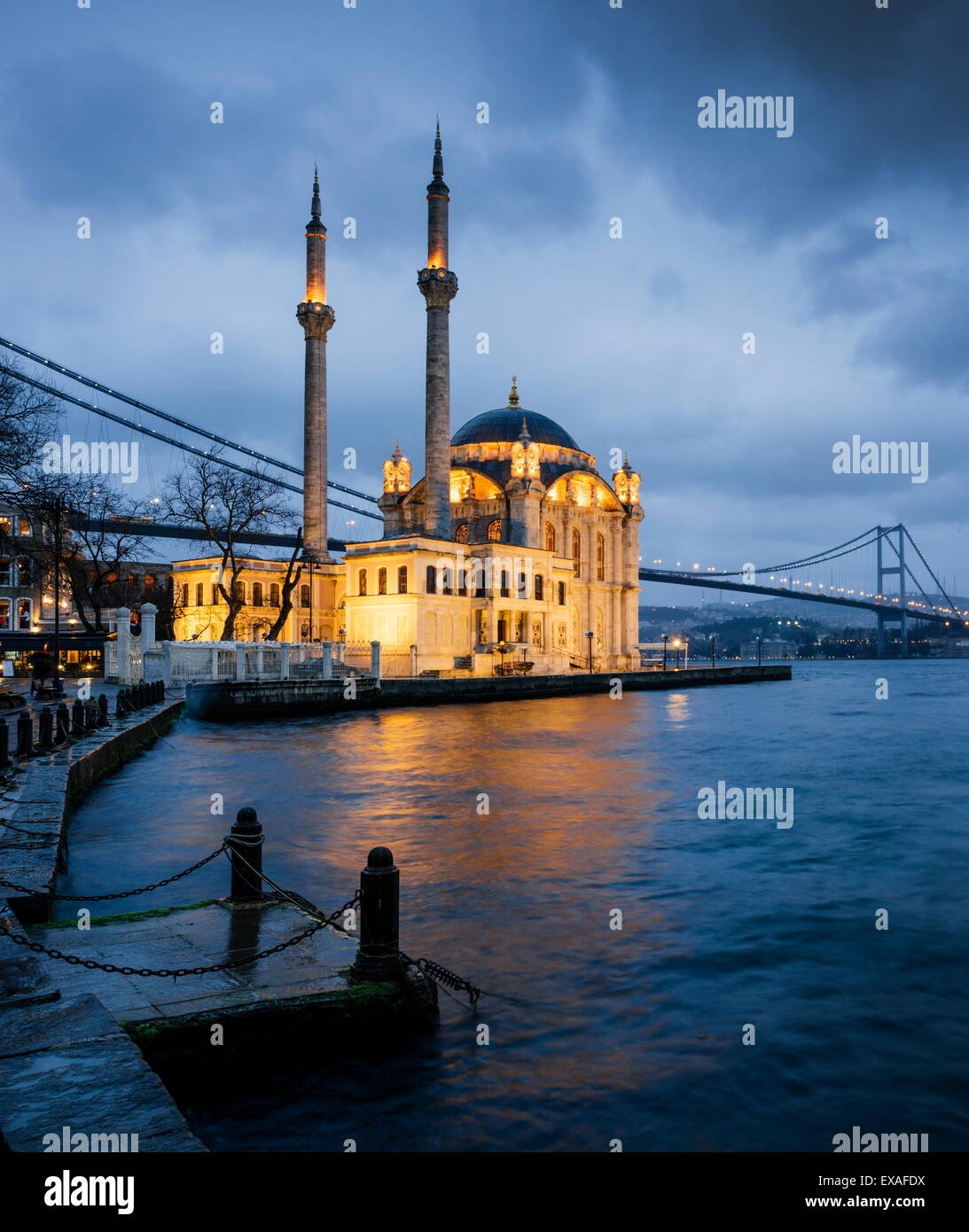 Exterior of Ortakoy Mosque and Bosphorus bridge at night, Ortakoy, Istanbul, Turkey, Europe - Stock Image