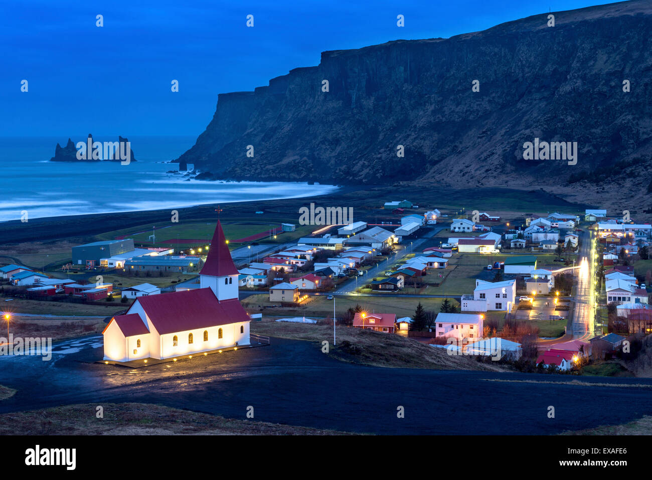Twilight view across the small town of Vik, South Iceland, Iceland, Polar Regions - Stock Image