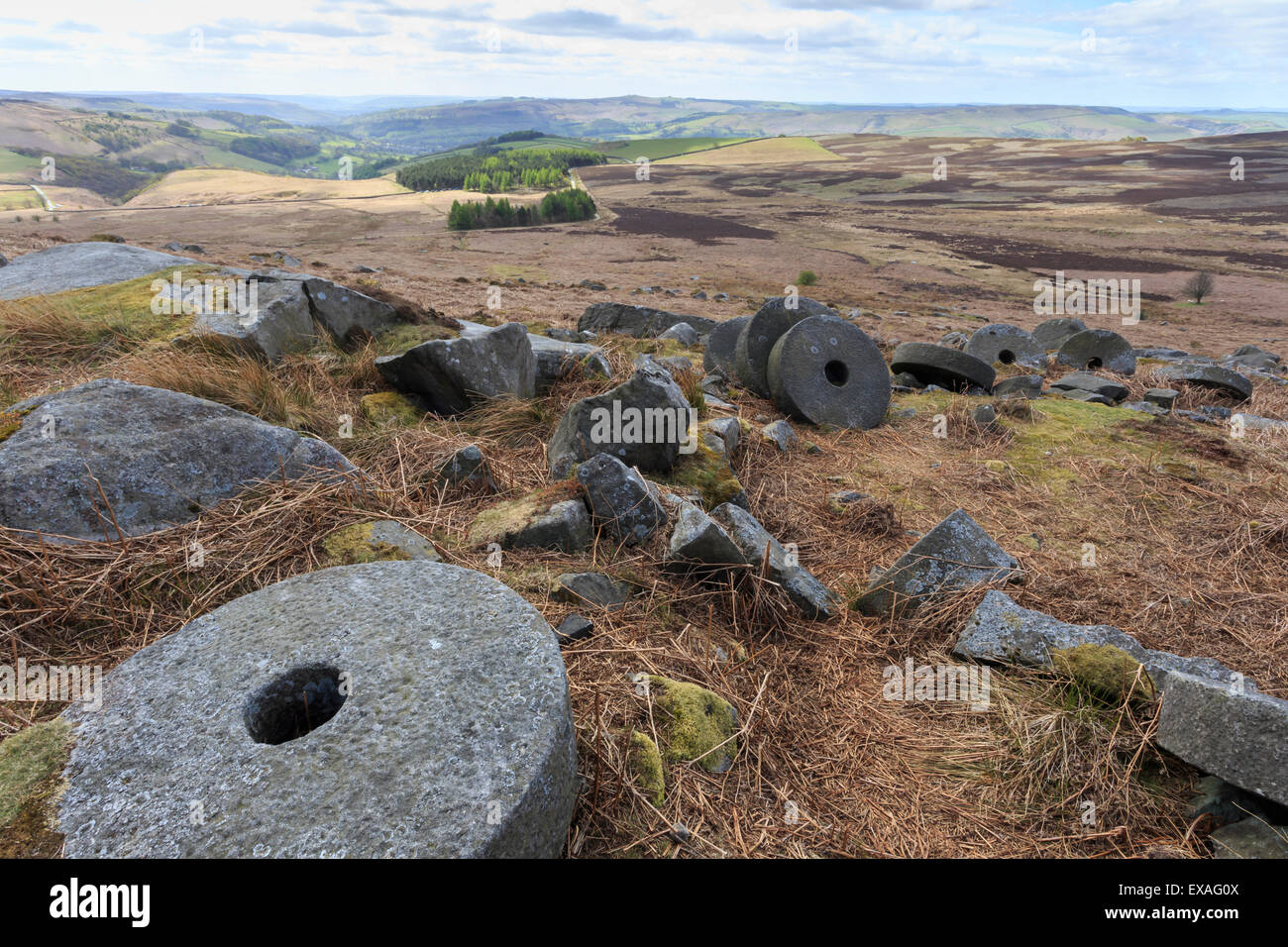 Old millstones, Stanage Edge, fine spring day, near Hathersage, Peak District National Park, Derbyshire, England, - Stock Image