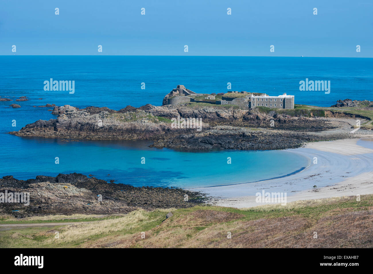 View over Chateau A L'Etoc (Chateau Le Toc) and Saye Beach, Alderney, Channel Islands, United Kingdom, Europe - Stock Image
