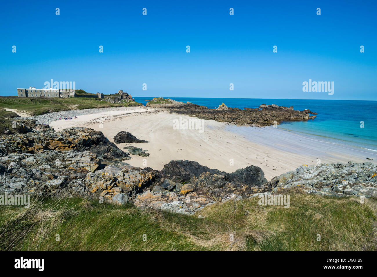 Corblets bay with Chateau A L'Etoc (Chateau Le Toc), Alderney, Channel Islands, United Kingdom, Europe - Stock Image