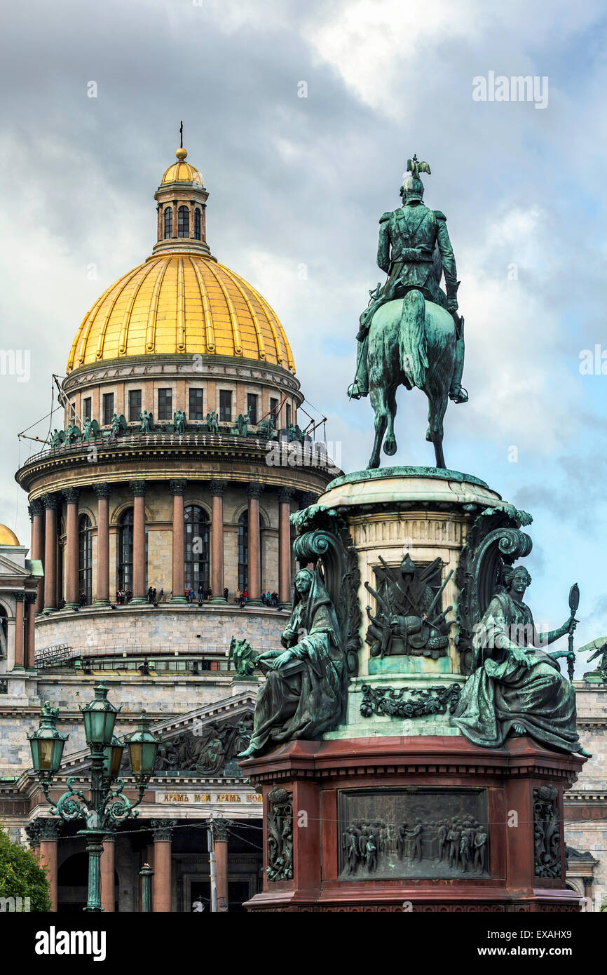 Golden dome of St. Isaac's Cathedral built in 1818 and the equestrian statue of Tsar Nicholas dated 1859, St. - Stock Image