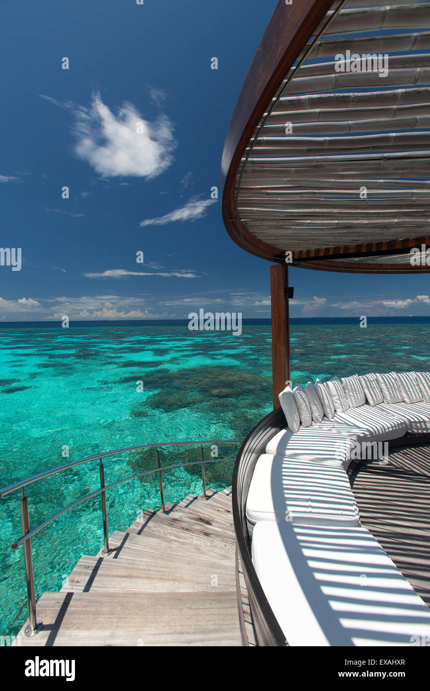 Stairs to the beach and sofa overlooking the ocean, Maldives, Indian Ocean, Asia - Stock Image