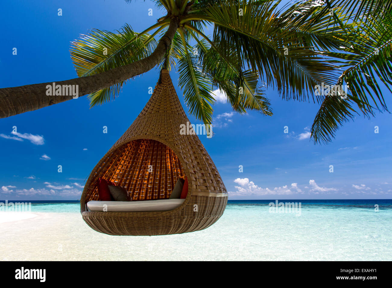 Sofa hanging on a tree on the beach, Maldives, Indian Ocean, Asia Stock Photo