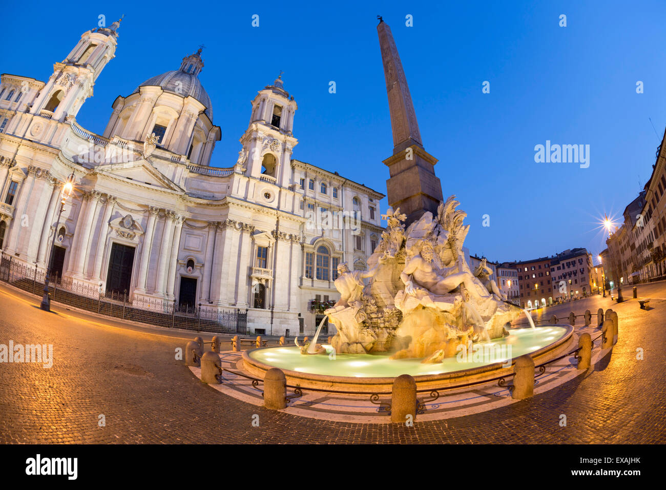 Bernini's Fountain of the Four Rivers and church of Sant'Agnese in Agone at night, Piazza Navona, Rome, - Stock Image