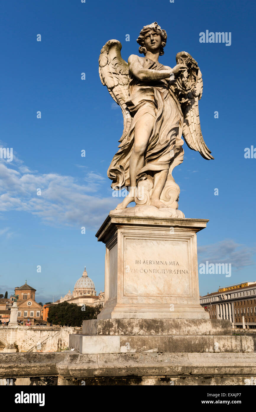 Bernini's breezy maniac angels statue on the Ponte Sant'Angelo with St. Peter's Basilica behind, Rome, - Stock Image