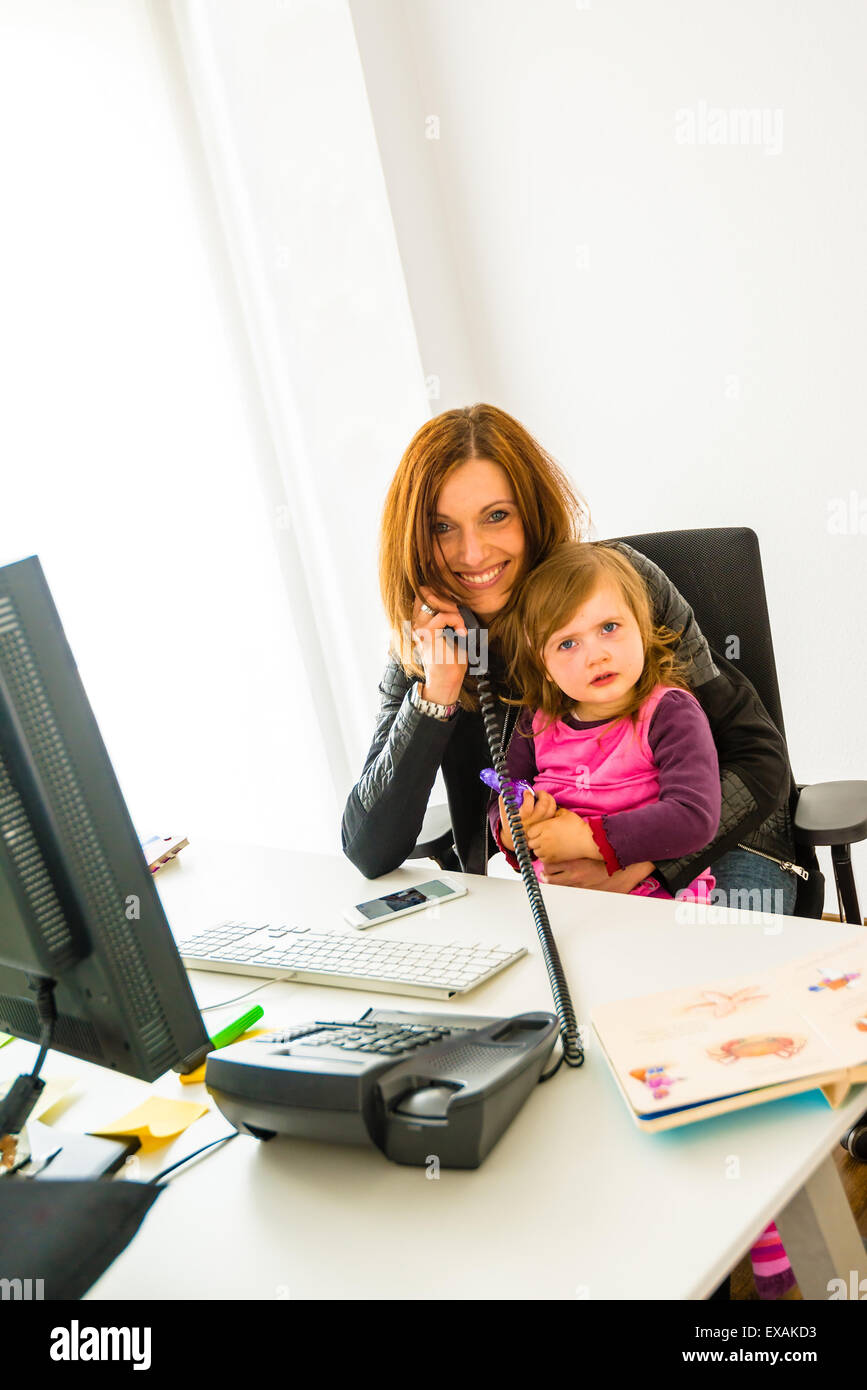 Reconciliation of family and work life - Stock Image