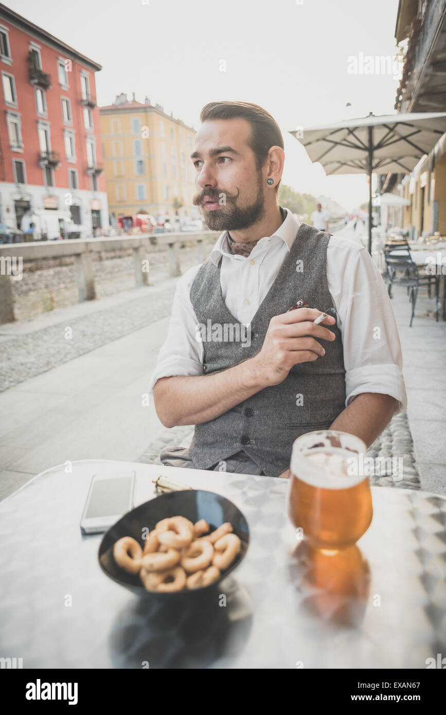 handsome big moustache hipster man in the city - Stock Image