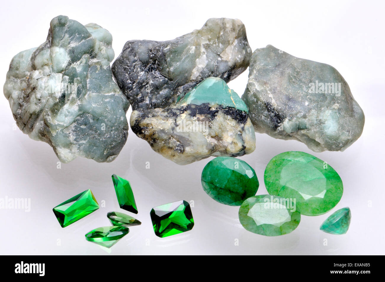 Emerald - rough mineral and cut gemstones - Stock Image