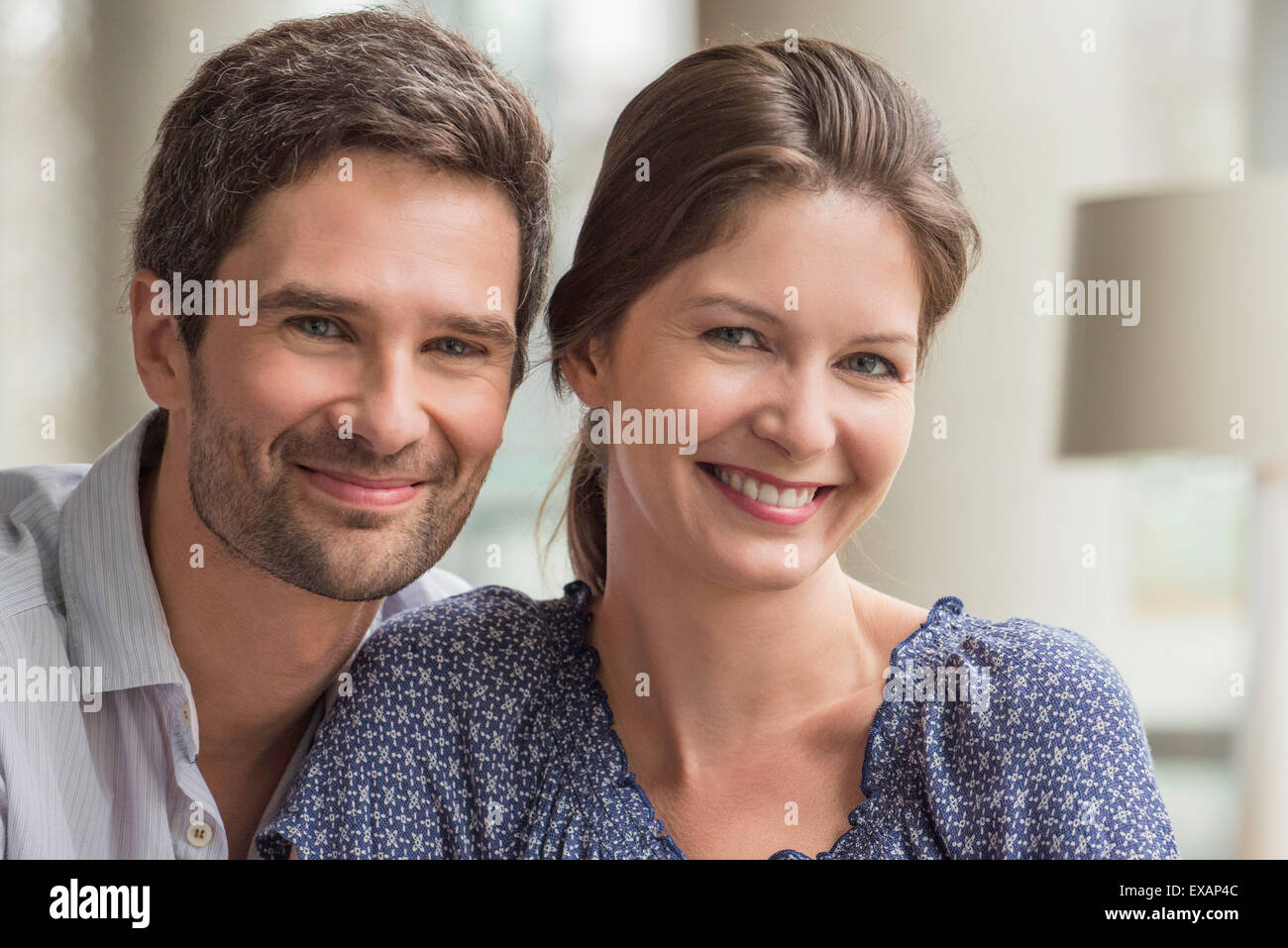 Couple together at home, portrait - Stock Image