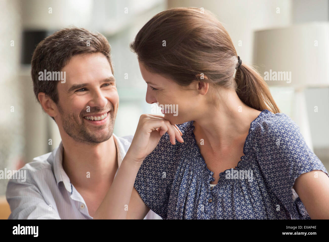 Couple smiling together at home - Stock Image